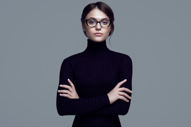 Cute student girl wearing black turtleneck sweater and stylish eyeglasses