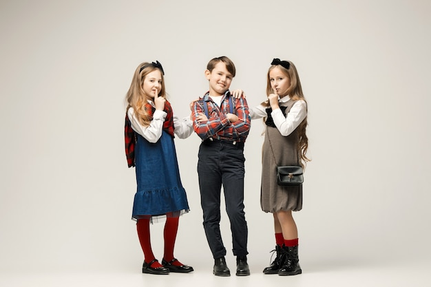 Cute stylish children on white  wall