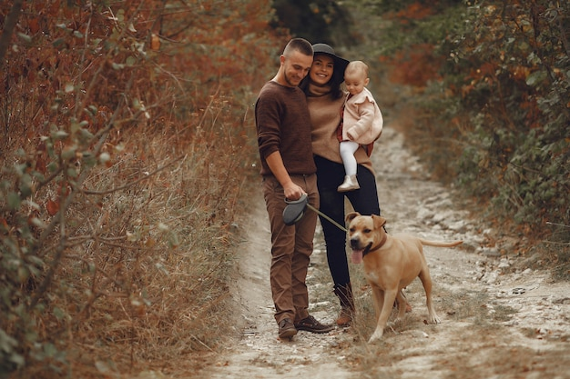 Cute and stylish family playing in a field