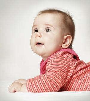 Cute surprised baby looking up