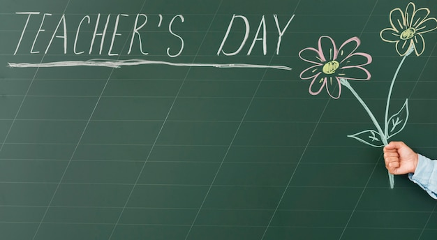Cute teacher's day drawing and text on blackboard