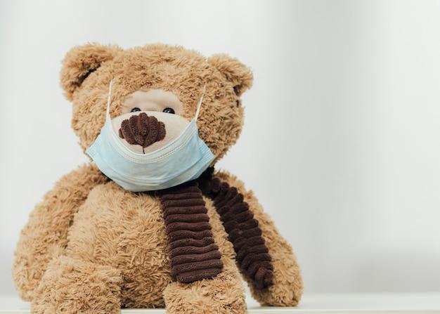 Cute teddy bear wearing medical mask
