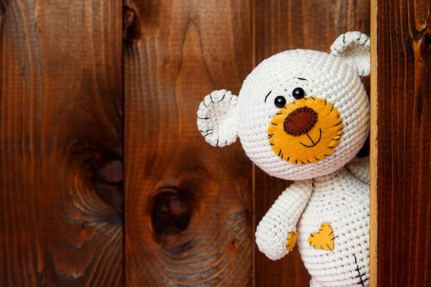 Cute teddy bear with old wood.