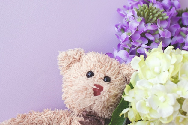 Cute teddy bear with pastel flower, valentine day is your love.