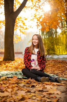 Cute teen girl posing in the forest