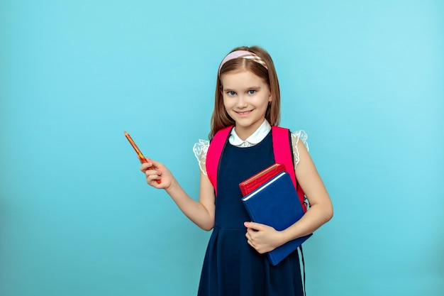 Cute teen girl with tablet pointing pencil isolated
