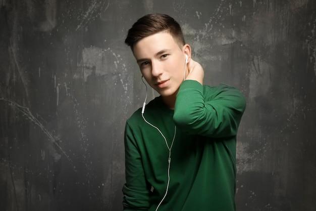 Cute teenage boy on grunge background