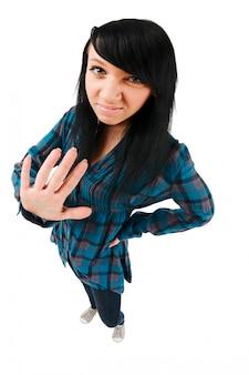 かわいい10代の少女、止めのジェスチャー