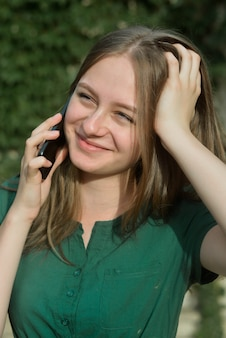 Cute teenager girl talking and smiling