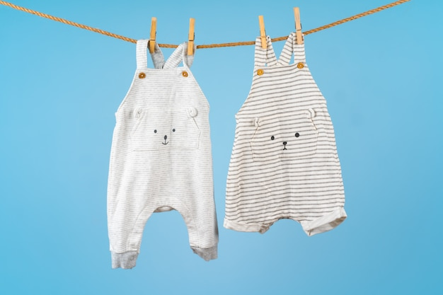 Cute toddler colorful clothing hang on a rope