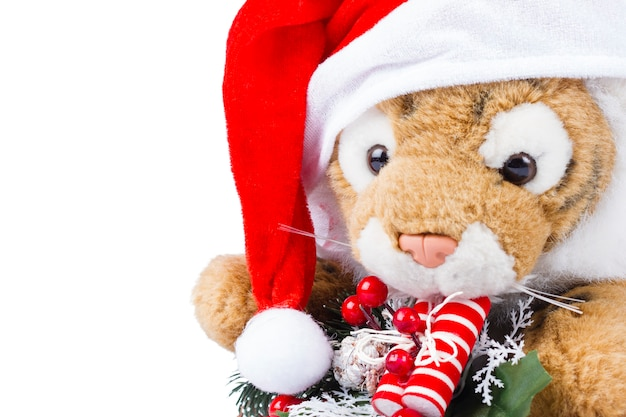 Cute toy tiger with christmas wreath