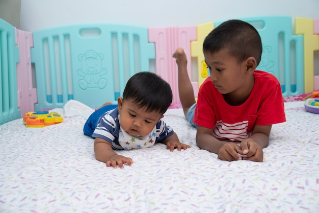 Cute two little boy play in room