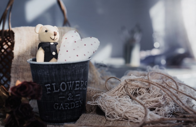Cute valentine's bear with white heart in aluminium bucket. valentine day concept