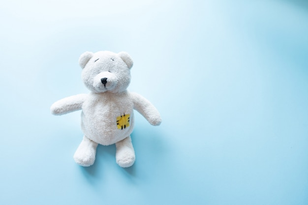 Cute white teddy bear child toy with visible upper body and open arms