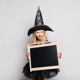 Cute witch with blackboard
