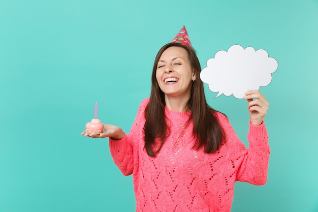 Cute woman in birthday hat with closed eyes hold cake with candle empty blank say cloud speech bubble for promotional content isolated on blue background. people lifestyle concept. mock up copy space.
