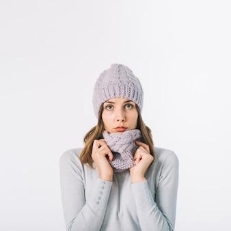 Cute woman in adjusting scarf