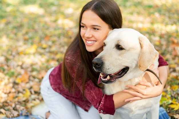 Cute woman in love with her dog