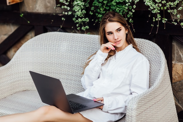 Cute woman making shopping online by laptop in the morning time.
