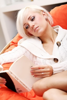 Cute woman reading book