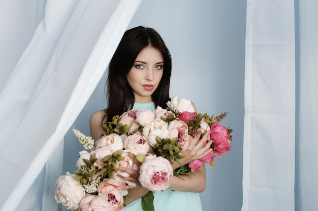Cute woman with floral bouquet