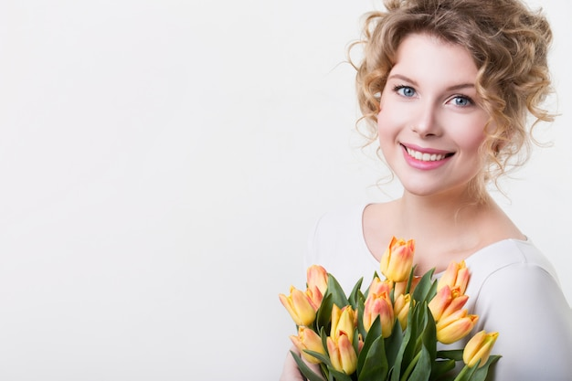 Cute woman with flowers