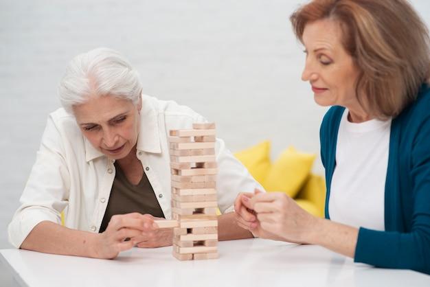 Cute women playing jenga together