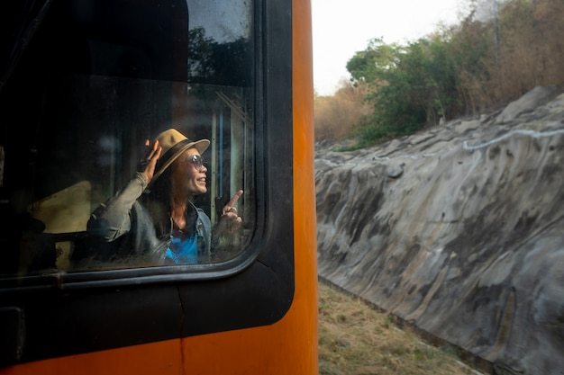 Cute women tourist smiling and looking for travel on train of summer