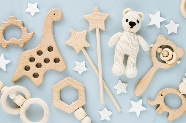 Cute wooden baby toys. knitted bear, rainbow, dinosaur toy, beads and stars.