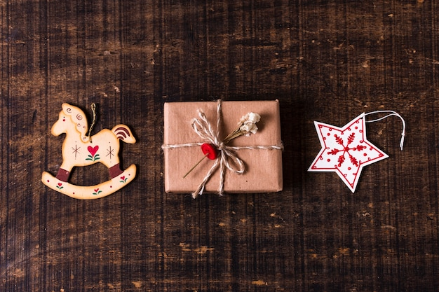 Cute wrapped gift with christmas ornaments