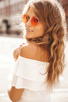 Cute young blonde woman with sunglasses