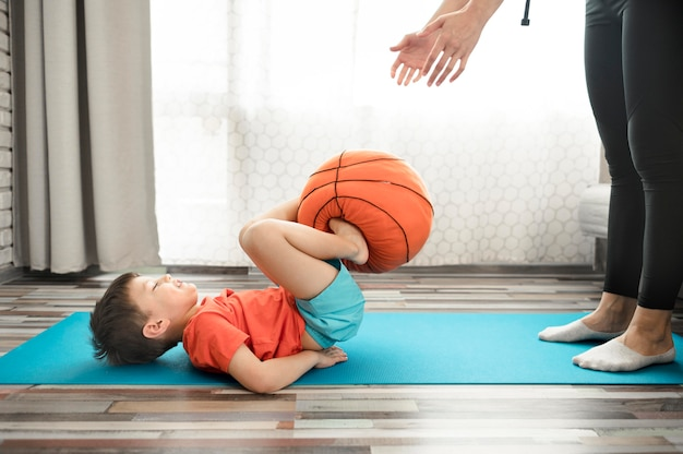 Cute young boy training with mother