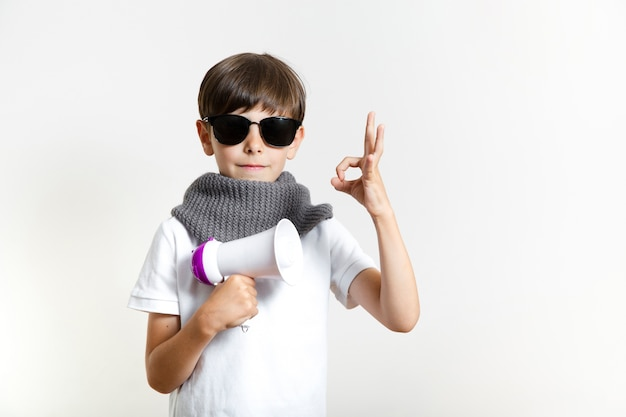 Cute young boy with sunglasses