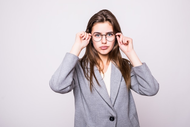 Cute young business woman with glasses on white background