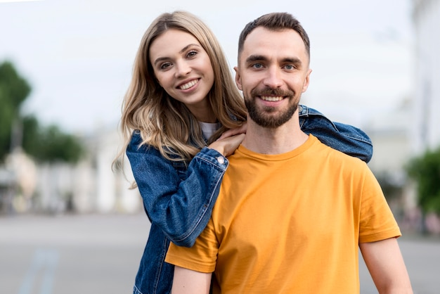Cute young couple smile at the camera
