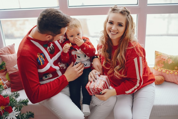 Cute young family sitting at home