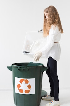 Cute young girl recycling concept