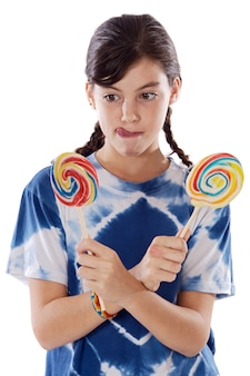Cute young girl with two lollipops over white background