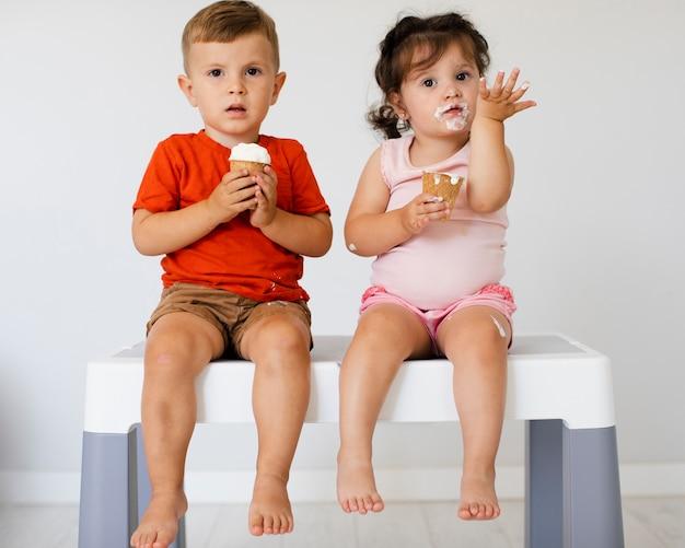Cute young siblings looking at camera