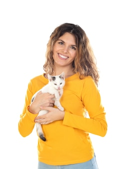 Cute young woman holding her cat isolated on a white