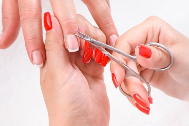 Cuticles cutting with scissors