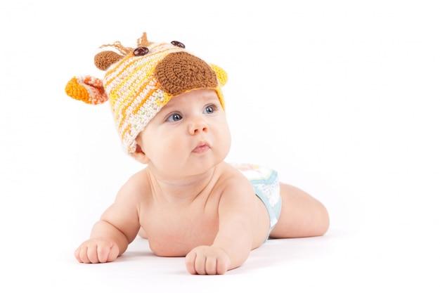 Cutie little boy in white diaper and deer hat
