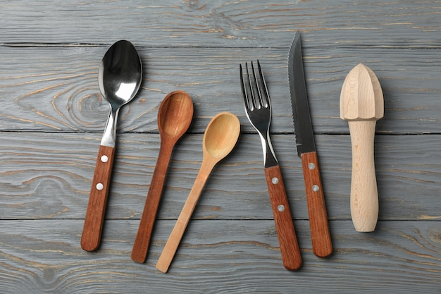 Cutlery on rustic wooden background, top view
