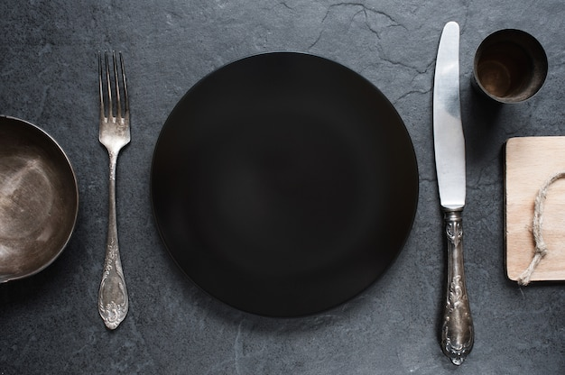 Cutlery setting in the dark colors