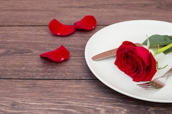 Cutlery with flower on plate