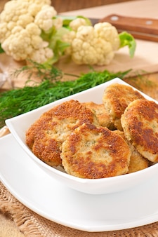 Cutlets cauliflower with fennel, garlic and cheese sauce