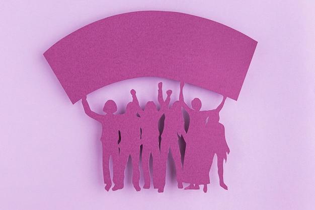 Cutout female figures in paper copy space