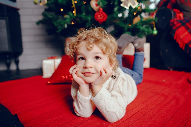 Cutte little boy at home near christmas decorations