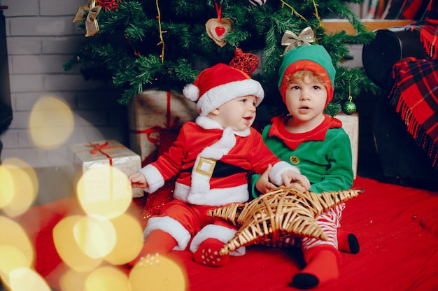 Cutte little brothers at home near christmas decorations