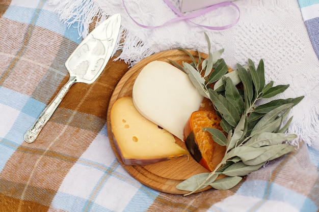 Cutted cheese on wooden plate